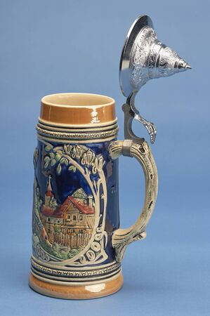 German beer stein with alpine decor and ornamental lid