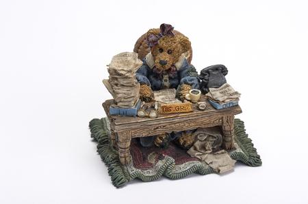 cluttered: ceramic ornamental figurine depicting bear working hard at cluttered desk