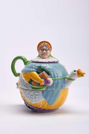 ceramic ornamental mother goose tea pot with mother goose riding goose Stock Photo