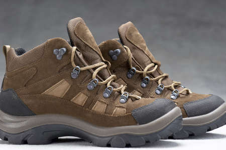 Pair of brown, ankle high hiking boots 版權商用圖片 - 55283810