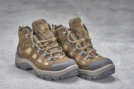 Pair of brown, ankle high hiking boots