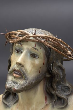 jesus christ crown of thorns: Jesus Christ ornament depicting Christ with crown of thorns and bleeding Stock Photo