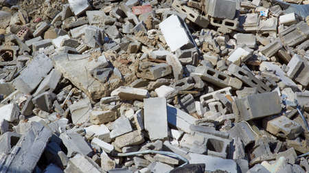 Rock,stone,bricks,concrete slabs piled to be used for erosion landfill Фото со стока