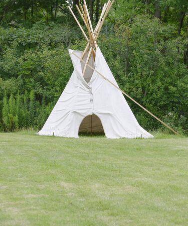 tipi: canvas tipi erected on meadows for overnight camping
