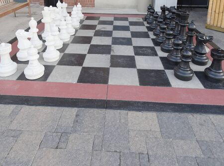 Sidewalk large checkerboard with chess pieces
