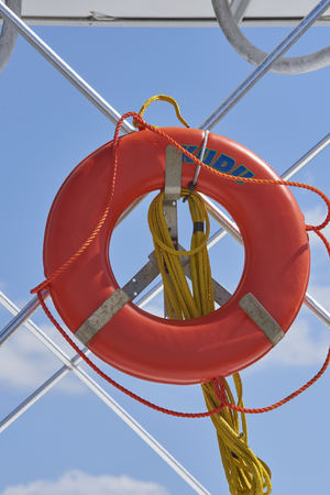 life ring and rope hanging on pleasure boat 版權商用圖片 - 79070387