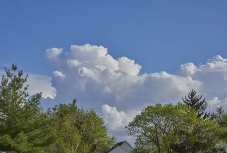 Clouds in late afternoon from deck of home 스톡 콘텐츠