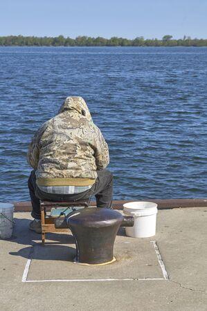 Finger Lakes, New York. Man on dock fishing. 스톡 콘텐츠 - 98797856