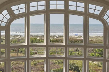 living room large window overlooking ocean front Redakční