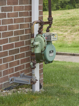 Natural gas meter attached to side of house