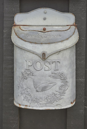 post box on door entrance to business