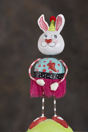 Figurines of Easter Bunny in colorful outfit Imagens - 117669924
