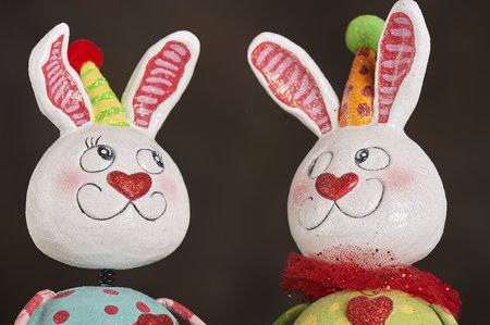 Figurines of Easter Bunny in colorful outfit