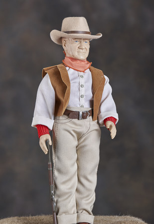Figurine of cowboy with hat and rifle