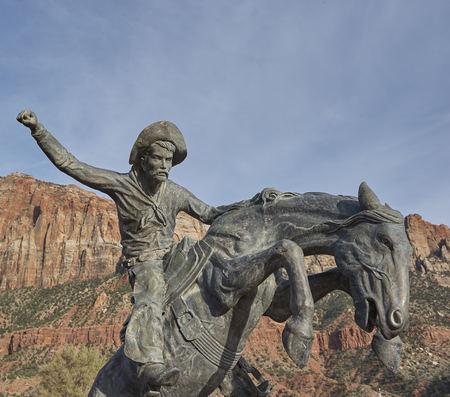 cowboy bronco horse statue
