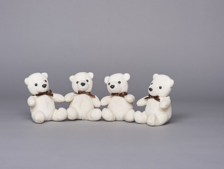 four white stuffed teddy bears