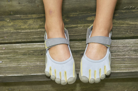 camper feet in beach shoes that fit like toes