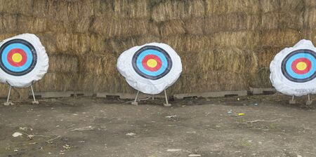 archery targets with hay bales as backstop
