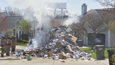 Garbage Truck fire in condominium complex during rubbish pickup