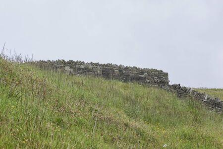 Ireland Trip (May 19-29, 2019) Cliffs of Moher, stone wall, on Atlantic Coast of County Clare, Ireland. Stone wall