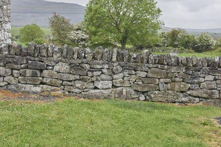 Ireland Trip (May 19-29, 2019) Corcomroe Abbey Village, stone wall, of Ballvaughan County of Clare, Ireland. rock wall