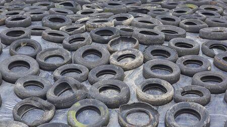 Trip to Ireland (May 19-29, 2019) Kilkenny Farmhouse Kilkenny, Ireland, mound of tires holding down plastic sheet