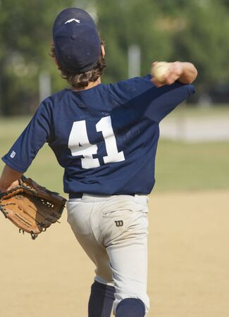Catholic Middle School Baseball Game.Player throwing baseball Stock Photo