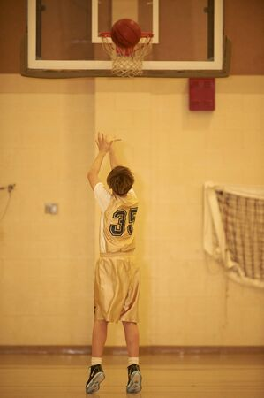 Gesu Catholic School Basketball  player shooting baskets Stockfoto