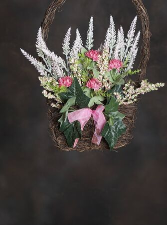 Easter Holiday Season basket of decorative flowers to hang on doors and windows