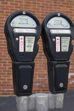 pair of parking meters on curb