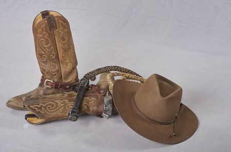 cowboy boots, spurts, bull whip, cowboy sombreo
