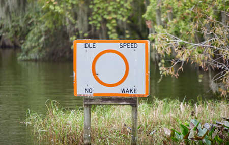 white, orange waterway speed sign for boating