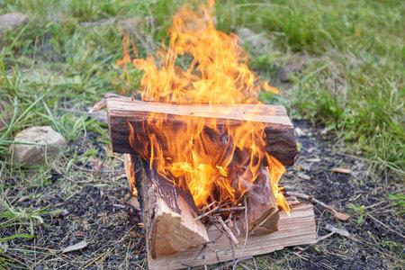 split logs burning in camp fire