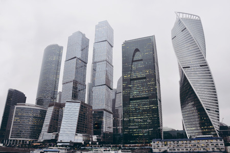 Big business city towers in autumn cloudy Moscow. Rainy day and modern buildings.