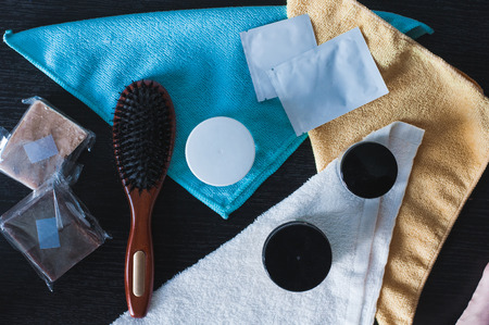Hair styling and care products. Hairbrush, soap for hair, gel and organic mask. Flatlay background Stock Photo