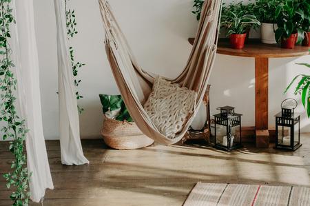 hammock in the manimalism bedroom interior. Pillows, plant Фото со стока