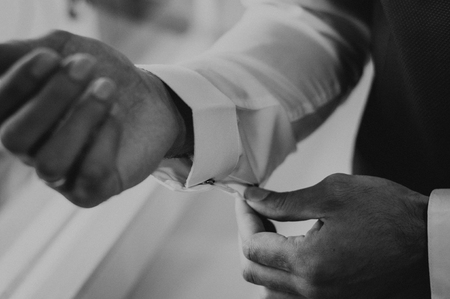 Man dress cufflinks in the wedding morning with white short. Elegant clothes