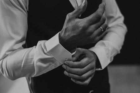 Businessman wear cufflinks. White luxury clothes