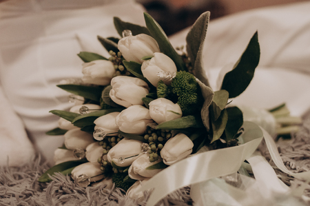 White wedding flowers near the bride in the morning. Holiday bouquet Фото со стока