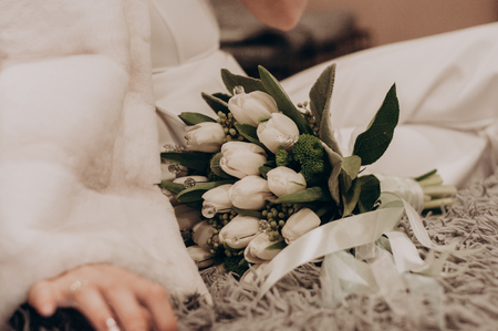 White wedding bouquet with boho decor closeup. Holiday flowers