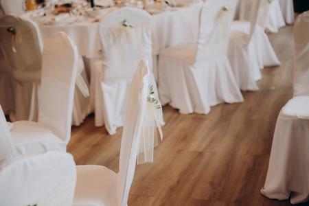 Restaurant celebration decoration. White romantic decor