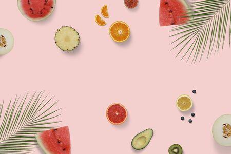 Summer exotic fruit top view flatlay with green palm leaves. Sliced watermelon, avocado, kiwi, orange, melon, grapefruit on minimal background Фото со стока