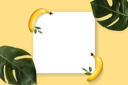 Summer banner with yellow banana and green leaves. Tropical concept with copyspace paper