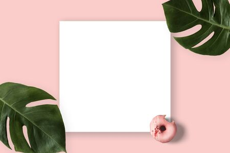 Summer banner with pink donut and green leaves. Tropical concept with copyspace paper