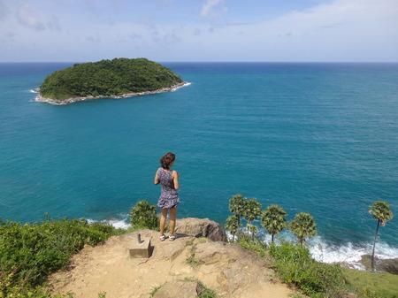 girl in dress looking on the ocean, thailand, phuket, Rawai photo