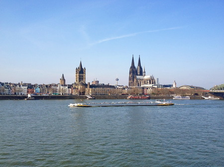 Vintage looking Koeln (Germany) panorama Including the gothic cathedral and steel bridge over river Rhine