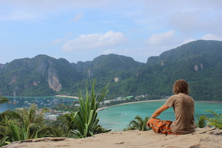 relexing young man, viewpoint on Ko Phi Phi Don Iceland, Thailand photo