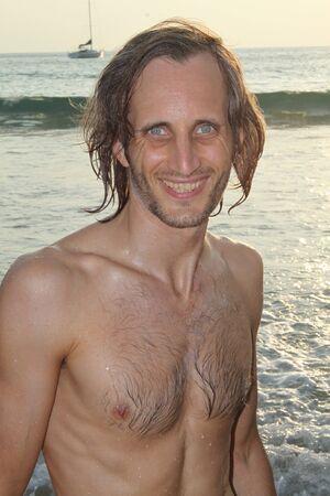 smiling young man on the beach, Thailand, Rawai beach, Phuket photo