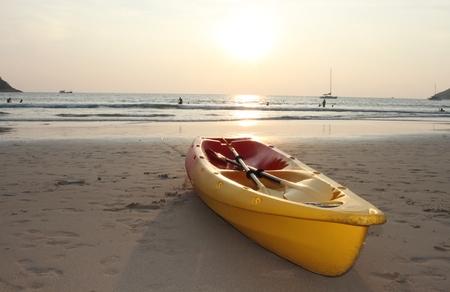 boat and sunset on Phuket Island, Rawai Beach, Thailand photo