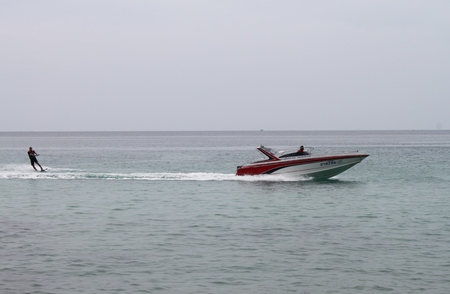 speedboat: speedboat, water sports on Nai Harn Beach, Phuket Island, Thailand, Boats Editorial